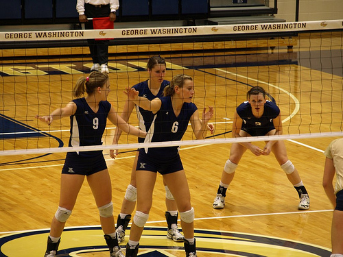 How to Communicate in volleyball.  Xavier Front Row Blockers Calling Out The Opposing Hitters photo by LT Mayers