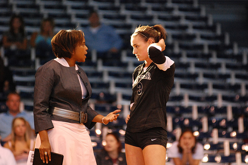 Good volleyball communication skills on the court during a game is crucial to your winning success. (Big East Butler coach talks to her setter)