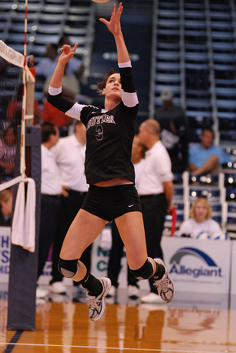 Communicate in volleyball. Left handed front row setter dumps the ball over the net.