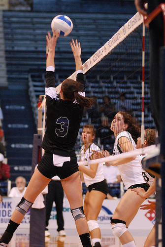 When players are taught to pass a volleyball, they are taught to pass to the right of the center of the net which is the area that separates zone 3 from zone 2. Butler setter at the net.