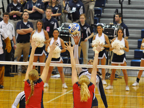 Penn State Volleyball Player Tipping Over A Double Block  Photo by John O'Brien