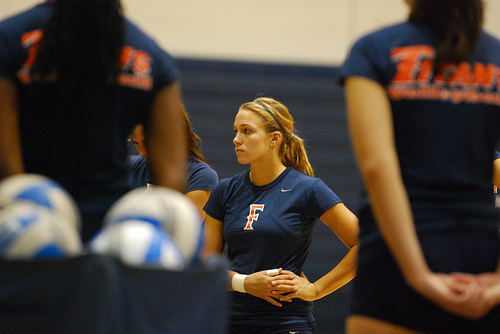 Cal State Fullerton Titans volleyball players at practice preparing to do volleyball drills.