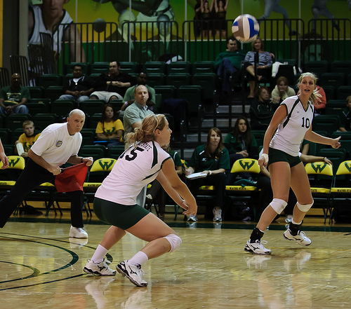 Volleyball Pass Techniques: Watch The Ball Before It Crosses The Net: Tracking the ball early while its in the opposing server's hands is the key to better volleyball passing technique.  (CE Andersen)