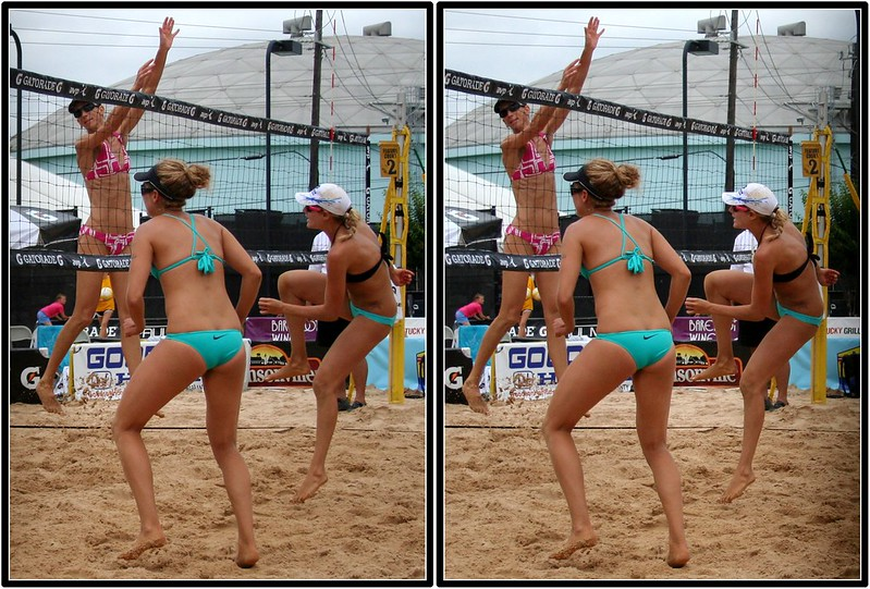 Jen Kessy hits against blocker Dianne DeNocochea while partner April Ross watches (Fossil Mike)