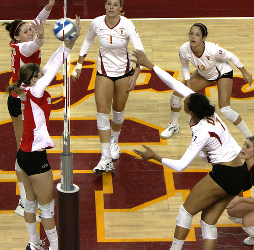 While blocking in volleyball a player can't touch the net on the way up or on the way down with any parts of the body while the ball is in play. (Neon Tommy)