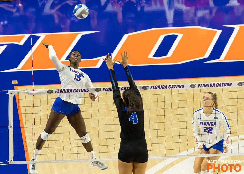 The outside blocker (#4) sets the block according to pre-determined tactics taking away the Florida hitter's cross court. (Matt Pendleton)