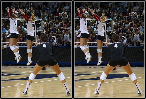Stanford Volleyball Libero #4 Dark Colored Jersey Digging Behind The Block (Michael E. Johnston)