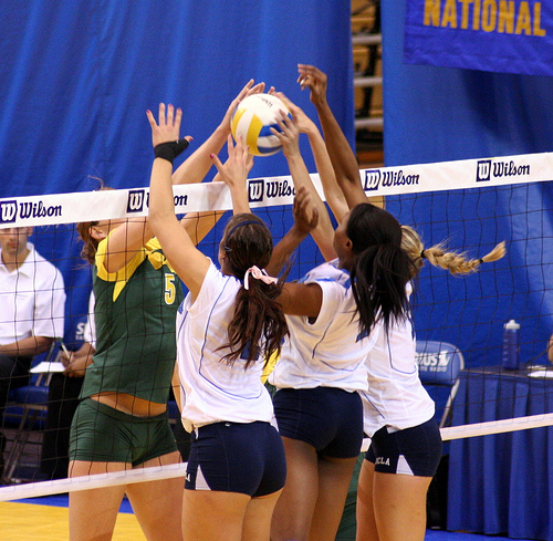 Volleyball spikes: UCLA vs Oregon Players in a Joust At Net (JMR Photography)