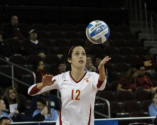 Serve The Volleyball Overhand: USC Player Volleyball Low elbow during serve (Photo Neon Tommy)