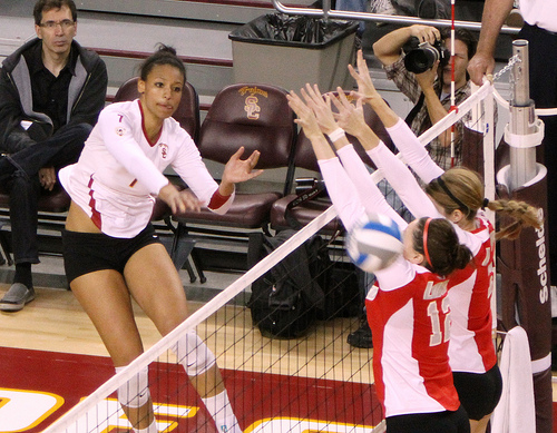 Volleyball rules for communication: USC hitter attacks cross court past the double block