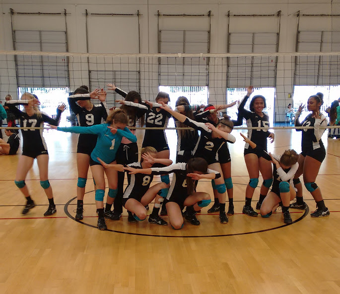 Volleycats Elite Panthers coached by April Chapple dab after finishing first in their pool on Mandatory Day 3 in the SCVA tournament.