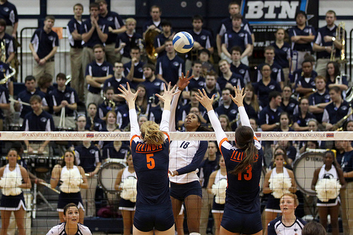 5 basic rules of volleyball:Penn State Volleyball Player Tipping Over The Illinois Blockers  photo by Richard Yuan