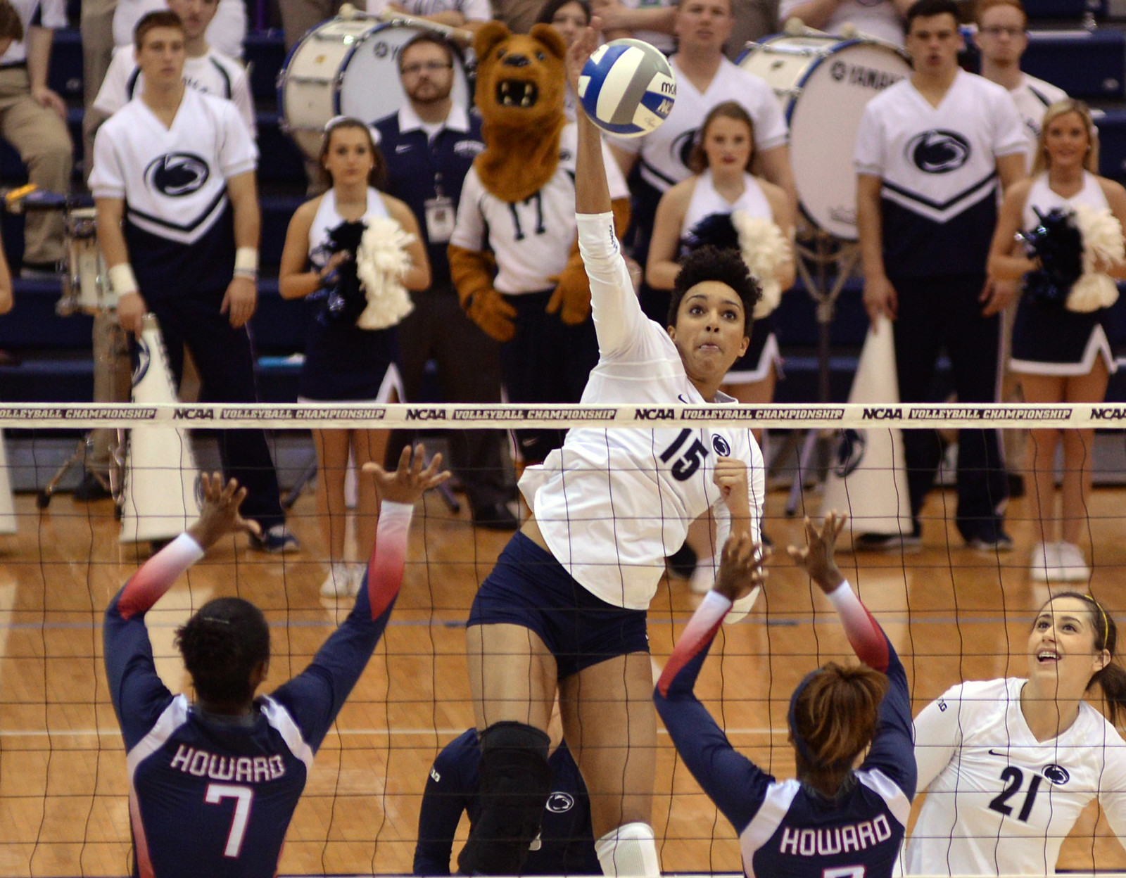 Penn State middle hitter Haleigh Washington attacks from the middle (Al Case)