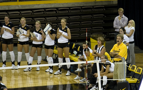 A head coach or an assistant coach while seated on the team bench will hold up a finger so only you can see it and that finger will tell you where you need to serve. (Jon Fravel)