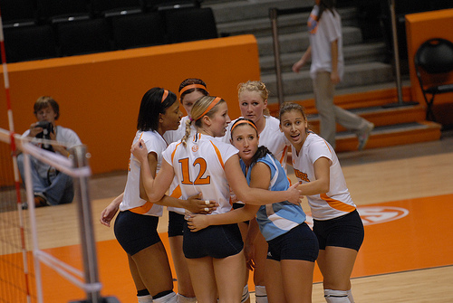 Tennessee Volunteers volleyball team huddle during a Southeastern conference match.