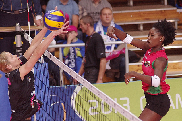 How to spike volleyball strategies: USA Olympian, Pro Player Megan Hodge hits around the block with an offspeed shot (Jaroslaw)