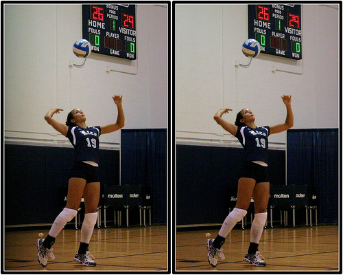 Serve The Volleyball Overhand:Rice Player Tossing The Ball For Her Serve Photo by Michael E. Johnston