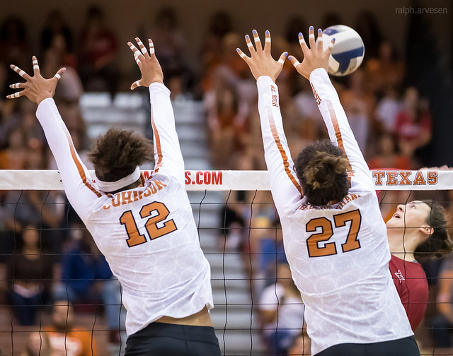 Middle Blocker Volleyball Position Offensive and Defensive Duties: Texas Longhorns middle blocker and outside hitter blocks cross court together against the attack (Ralph Arvesen)
