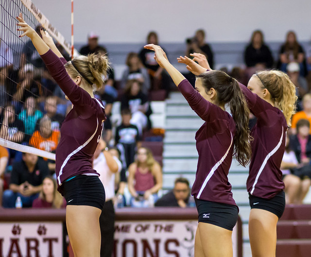 What's the block in volleyball?  Varsity blockers with hands way above their heads (Ralph Arvesen)