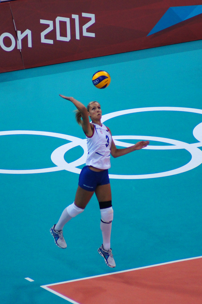Ivana J. Derisilo Serbian player with overhand jump volleyball serving during the London 2012 Olympics. (Daniel J Coomber)