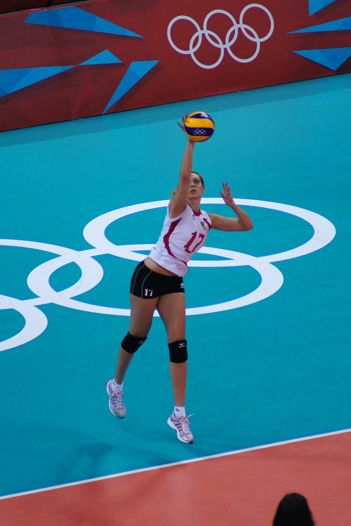 Lydia Oulmou Algerian player with overhand jump volleyball serving during the London 2012 Olympics. (Daniel J Coomber)
