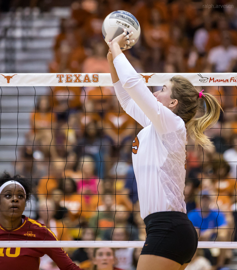 The Middle Volleyball Blocker: Iowa State middle blocker watches the Texas Longhorns setter just as she sets the ball to one of her hitters (Ralph Arvesen)