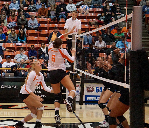 A left handed setter tip the ball faster but she's in a better position to dump the ball over the head of the opposing left front blocker