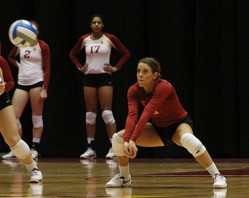 Learn Volleyball: Digging means to sink your hips low to the floor, below the ball before it gets to you and you use your extended arms in your platform to