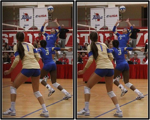 Tulsa volleyball setter jump sets the ball to the outside.