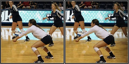 Conference USA Rice libero with straight arms, elbows and wrists that create a platform with her volleyball handa which is what the ball contacts when passing. (M.E. Johnston)