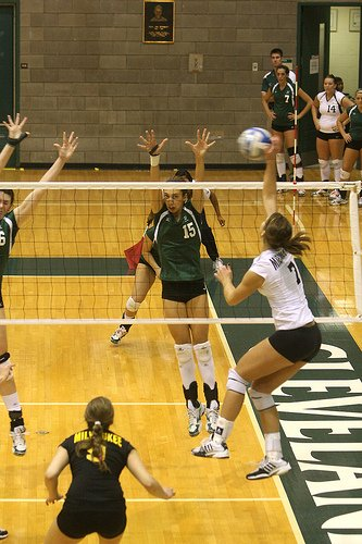 Volleyball Hits:  Cleveland State right side hitter attacks the ball cross court form Zone 2
