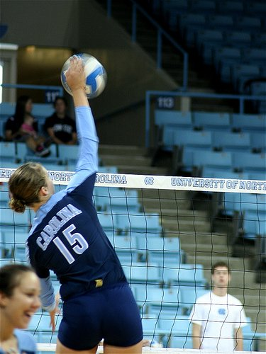 Outside hitters are taught to aim their hard driven spike in volleyball to specific areas on the court in order to score points in a rally.
