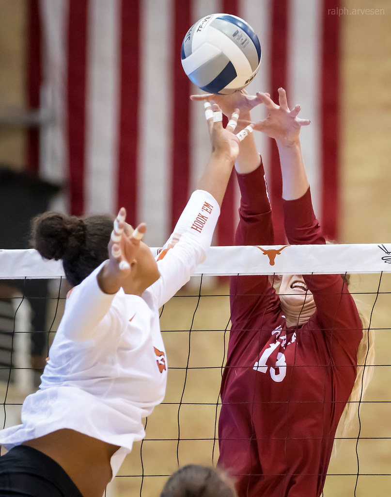 Oklahoma blocker with proper blocking finish- hands and arms sealing off space between her armpits and the net to reach as far over the net as possible. (Ralph Arvesen)