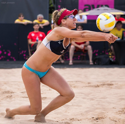 To improve your beach volleyball passing accuracy learn where to stand on the court, how to stay on top of the sand, why you should pass first. (April Ross passing by Ralph Aversen)