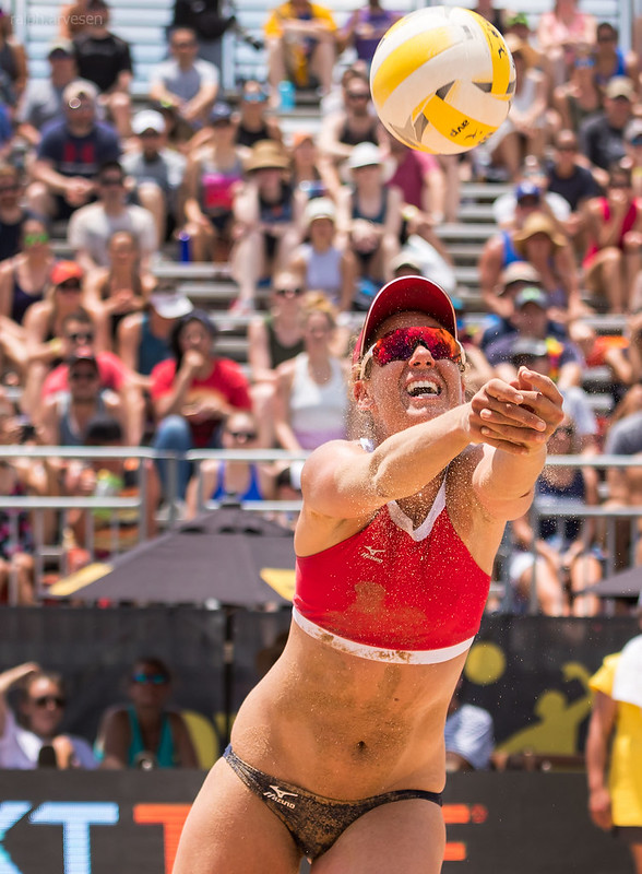 Two-time Olympian and silver medalist April Ross bump sets a ball during AVP competition in Texas.(Ralph Aversen)