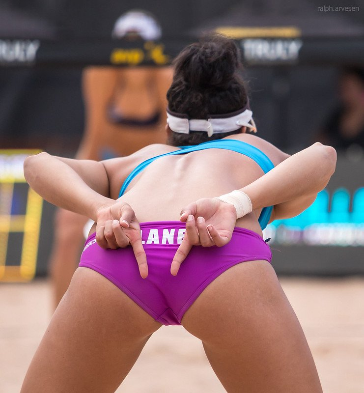 If your partner tells you to block both players down the line (like Lane is doing), then you know that she will be digging them cross court. (Ralph Aversen)
