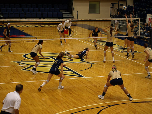 Terms Used in Volleyball Blocking: In the photo above #4 is the Offside Blocker, while #8 the Middle blocker and #2 the Right Side Blocker are actively blocking the ball.(Photo by Laurie Mayers)