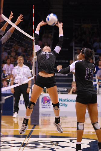The setter back sets to the right side hitter in Zone 2.