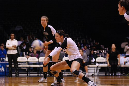 When passing in volleyball contact the ball on your forearms not on your hands. To control a hard serve the ball makes contact above your wrists and below the insides of your elbows.