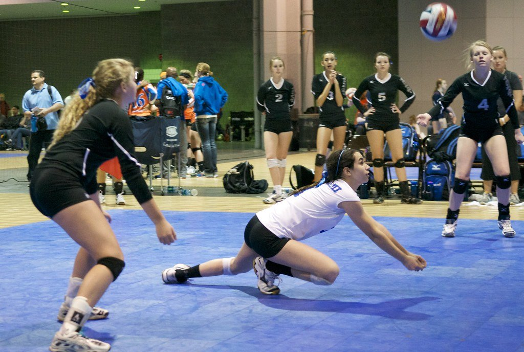 A volleyball defensive player like a libero or defensive specialist needs to be aggressive in the backrow while passing, digging and communicating well. (Denis Wright)