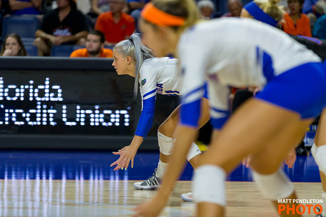 Dig more volleyballs by watching the the ball, the setter, the ball and then the hitter when the opposing team attacks the ball.  (Matt Pendleton)