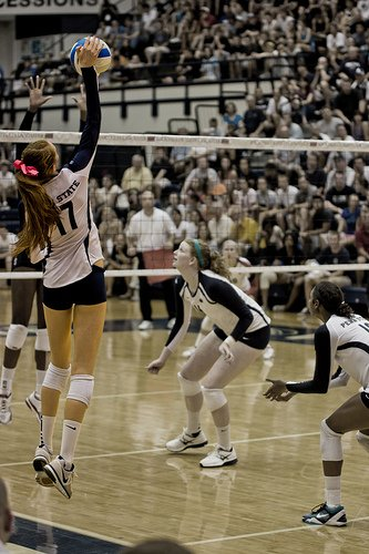 Smart hitters look for volleyball tipping opportunities to outsmart the opposing team's defense. After you've hit a few balls hard on the next good set tip the ball to an open space. (Gallery Three)