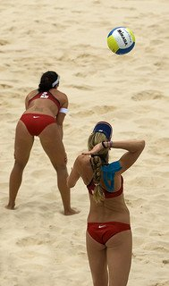 Beach Volleyball Play: Just like in the indoor game, the overhand volleyball serve on the beach is the first opportunity for a player to serve a point. (Craig Maccubbin)
