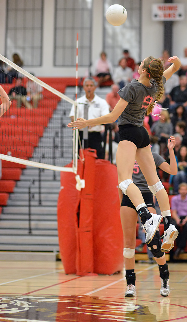 Volleyball Techniques: 6 Specific Skills Varsity Players Need To Know: Varsity middle hitter hits a quick attack in the middle (Al Case)
