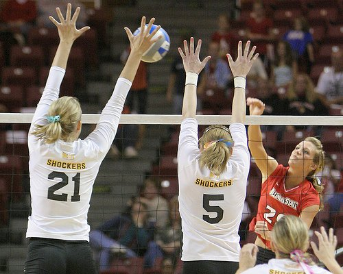 Middle Blocker Volleyball Position: Middle blockers travel laterally along the net to put up a block by themselves or with their outside blockers to stop a hit cross the net. (Bill Shaner)
