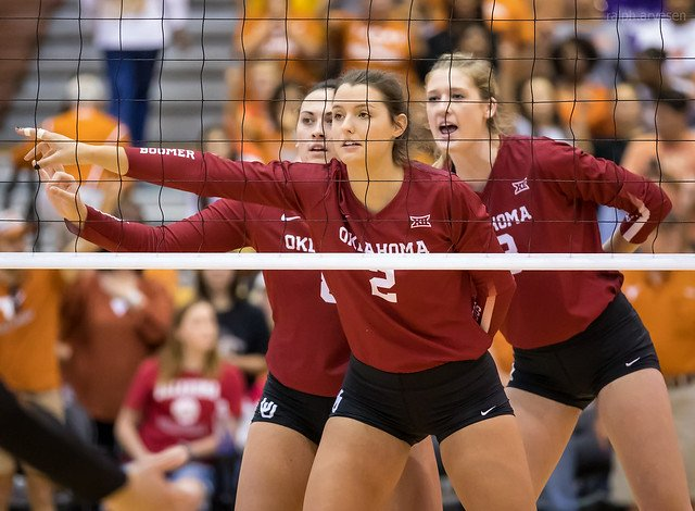 Oklahoma Sooner blockers call out the hitters on the opposing team (Ralph Arvesen) Before your team serves your front row players and back row players should be talking on the volleyball court.