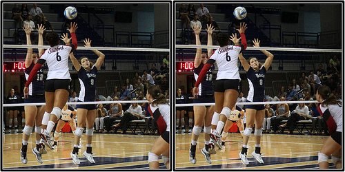 The hitter at the height of their jump will tip the ball softly over the double block in hopes that the ball lands in an open area of the court (Michael E. Johnston)