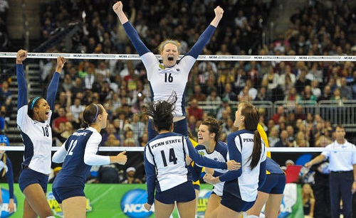Volleyball rules for communication: Penn State volleyball players celebrate a point.