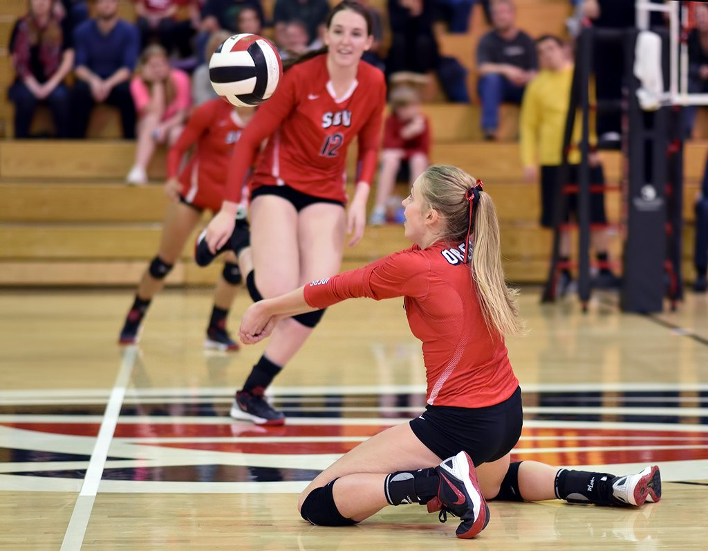 Make a volleyball platform with your forearms by clasping your thumbs together pointing them to the ground so ball contacts above the wrists and below elbows. (Al Case)