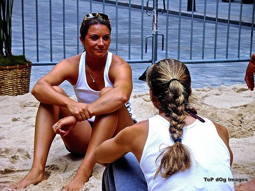 Former teammates Misty May Treanor and Kerri Walsh Jennings talking to each other between volleyball tournament matches. (Top Dog images)